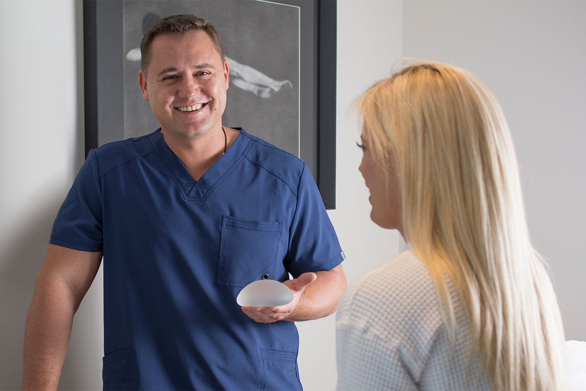 Dr. Mark with patient during a breast augmentation consultation.
